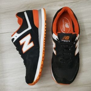 New Balance 574 Classic in Black and Orange